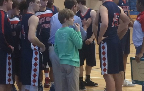 Varsity Basketball Shows Mettle in Conference Tournament