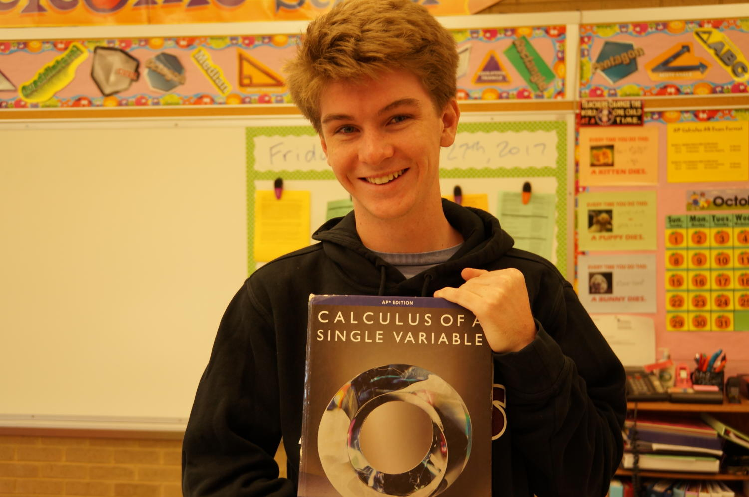 Thomas Newton with his beloved AP Calculus book.